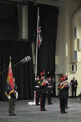 Gnr Marshall & Gnr Graham ready to lower the flag