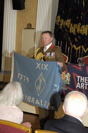 Regt Col receiving a flag from his old regiment