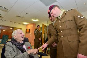 Harry Molineaux aged 105, with members of 12 Regt RA.