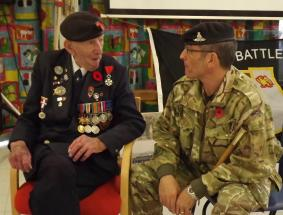 BSM Billy Reid takes advice from a D-Day veteran in the margins of a recent visit to a local school, November 2016
