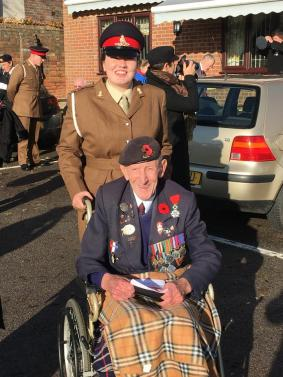 Gunner Hourihane gives Branch member Stan Bowyer a helping hand during the 2016 Remembrance Day parade